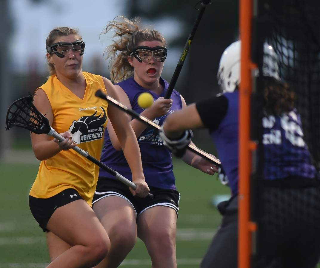 The Madison Mavericks beat the Branford Sting 16-8 in the Dream League Girls Lacrosse game held at the Madison Surf Club Tuesday night. Regan Larson (17) Photo by Kelley Fryer/The Source