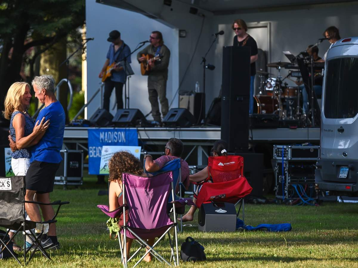 Madison Beach and Recreation held the Sunday Summer Concert Series on the Town Green from 6:00pm - 8:00 pm featuring The Larry Stevens Band.Cliff and Debbi Collins were the first up dancing on the Green. Photo by Kelley Fryer/The Source