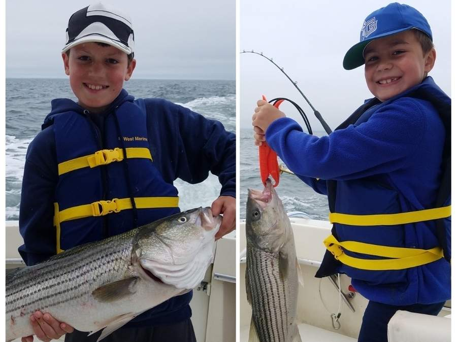 Luca Esposito, 10, and brother Rocco, 8, both of Guilford, caught these slot-limit mealtime striped bass while trolling in Long Island Sound. Photo illustration courtesy of Captain Morgan