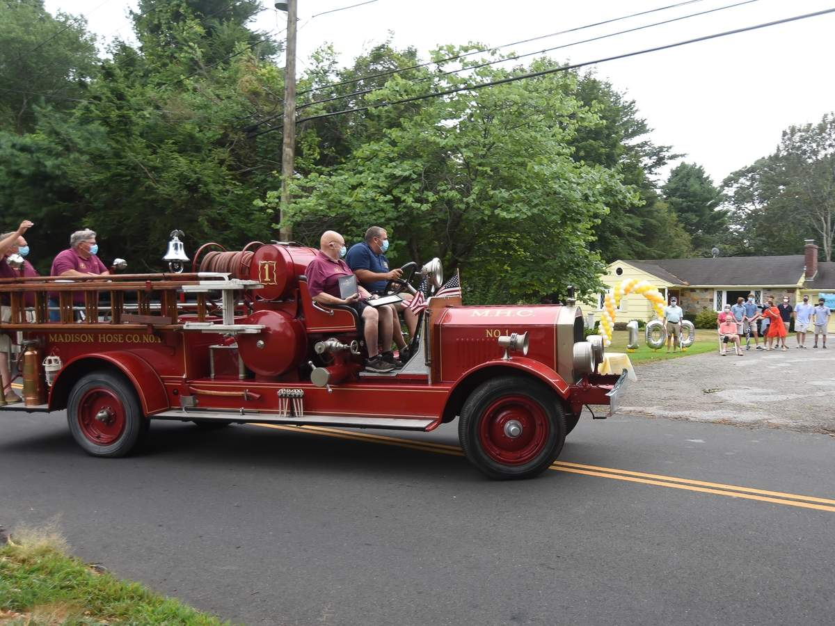 Family,  friends and the Madison Fire Department drove by to wish former Madison Fire Chief Adrain þÄúAdieþÄù Ellsworth Bassett a happy 100th birthday in Madison on Thursday, August 13, 2020.  Photo by Kelley Fryer/The Source