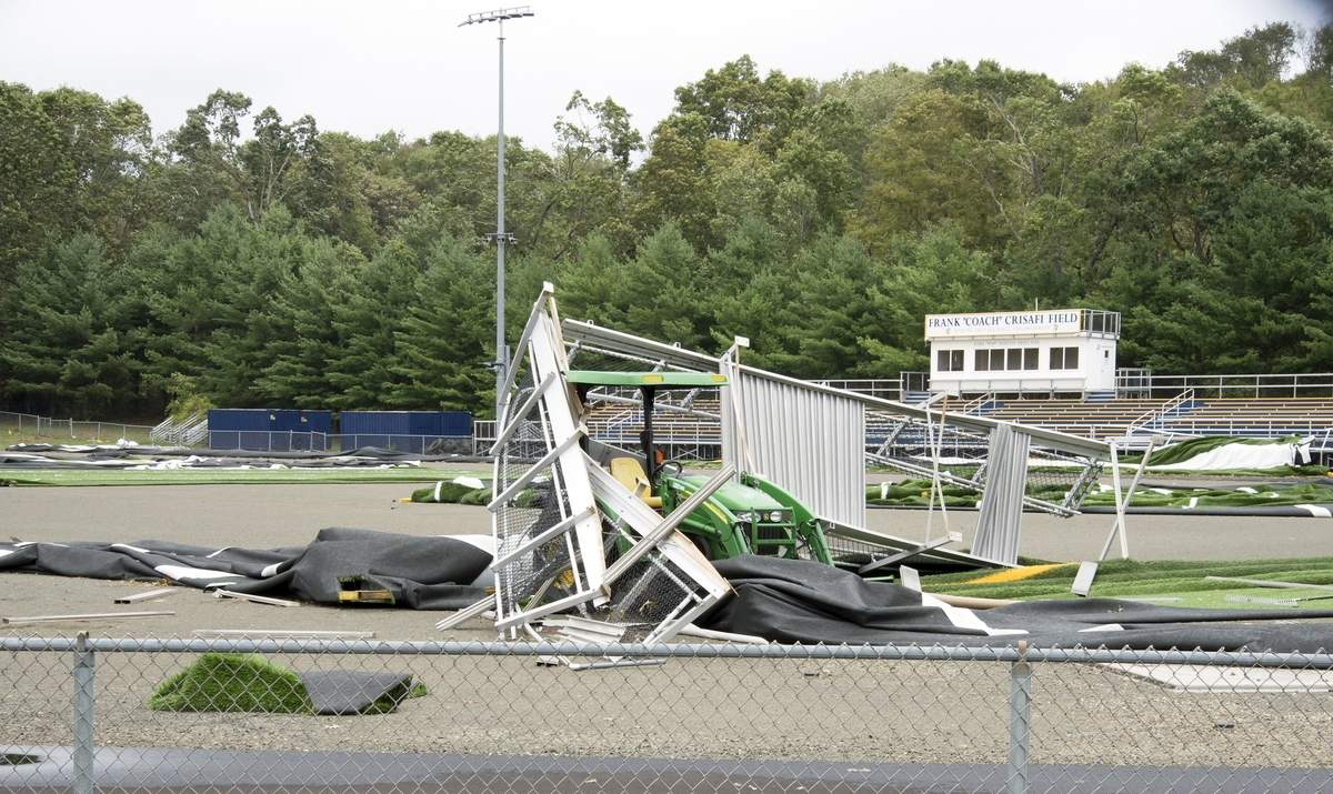 The East Haven High School track and football field were severely damaged in last Thursdays August 27 2020 storm.  A metal walkway is shown which was carried by the high winds and landed on top of a tractor.  Photo by Wesley Bunnell  / Courier