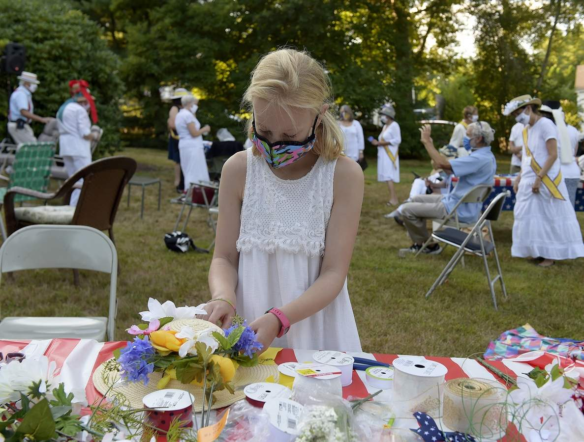 08/18/2020 :: REGION  :: STANDALONE :: Lucy Moore, 9, of Woodbridge attaches flowers to a hat Tuesday, Aug. 18, 2020, during a celebration of the 100th anniversary of Women's Suffrage in Mystic. The event, organized by the League of Women Voters of Southeastern Connecticut, celebrated the ratification of the 19th Amendment and featured performances of historic speeches as well as hat decorating and poster making. (Sarah Gordon/The Day)