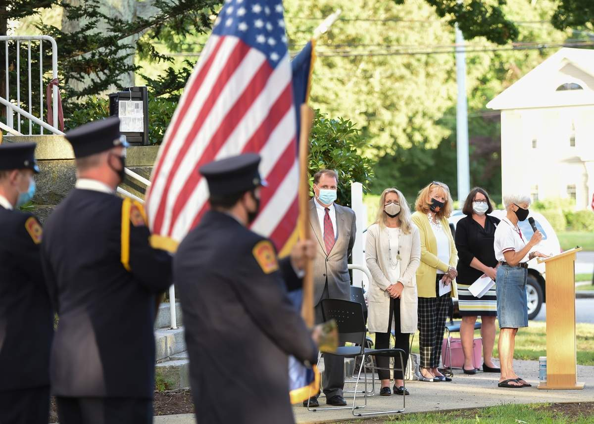 The Town of Madison in co-ordination with civic organizations, honored those individuals lost on 9/11 with a public ceremony  Friday evening at 6 p.m., September 11th at Memorial Town Hall, marking the 19th anniversary of the September 11th terrorist attack on our nation. Pam McKinnon welcomed everyone gathered, joined by Rev. Todd Vetter from the First Congregational Church, Madison, State Senator Christine Cohen, State Representative Noreen Kokoruda, and First Selectwoman Peggy Lyons.  Photo by Kelley Fryer/The Source