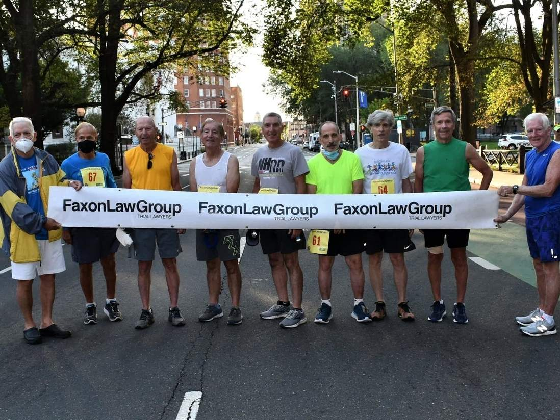 For the 43rd-straight year, a few local residents ran in the 20K Faxon Law Group New Haven Road Race, which was contested virtually this year. Pictured are the traditional starting line are New Haven Road Race vice president Frank Alvarado with runners Steve Praskievicz (Bethany), Jim Kennedy (North Haven), Peter Sanchez (Branford), Rick Conte (Branford), Charlie Matassa (New Haven), Walt Messersmith (Hamden), and Jim McCormack (West Haven), as well as previous New Haven Road Race president John Courtmanche. Photo courtesy of Bill O'Brien