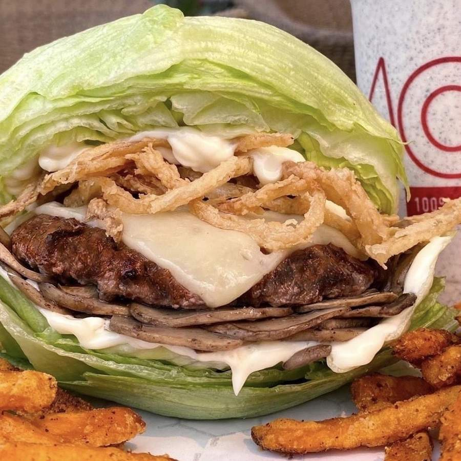 MOOYAH offers a wide range of burgers, and burger options, including vegan, paleo, keto, low cal, gluten-free, and vegetarian. It also offers lettuce wraps—and regular old burgers with buns. Photo courtesy of MOOYAH