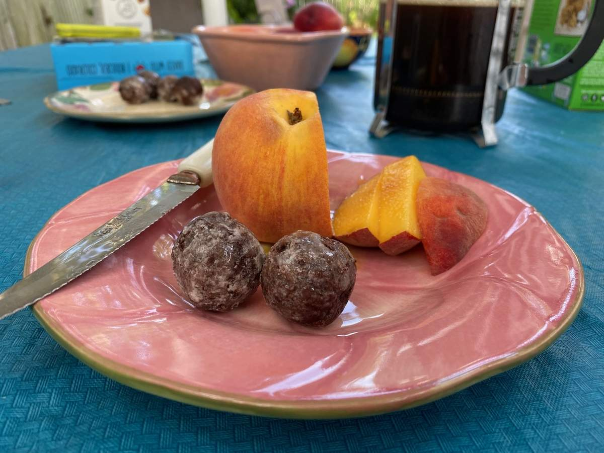 Don't let that healthy looking piece of fruit fool you. This breakfast was all about the chocolate glazed donut holes. Photo by Pem McNerney/The Source