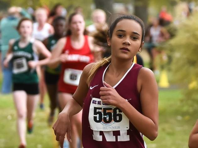 Payton Orosco and the North Haven girls' cross country team are competing against Hamden and Guilford in their season opener. File photo by Kelley Fryer/The Courier