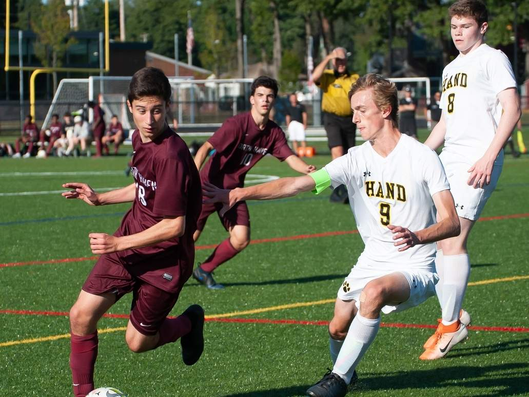 Senior Eduardo Cienfuegos de Paz scored two goals when the North Haven boys' soccer squad battled Hamden to a 3-3 draw in its season opener on Oct. 2. Pictured in the background for North Haven is junior Jack Pollard. File photo by Kelley Fryer/The Courier