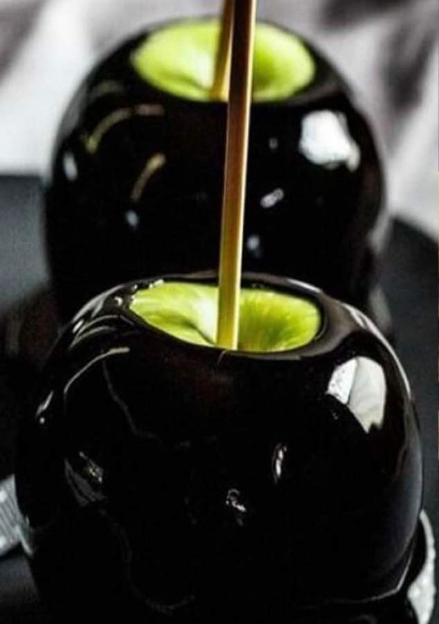 This black apple is perfect for Halloween.   Photo courtesy of Candy Works