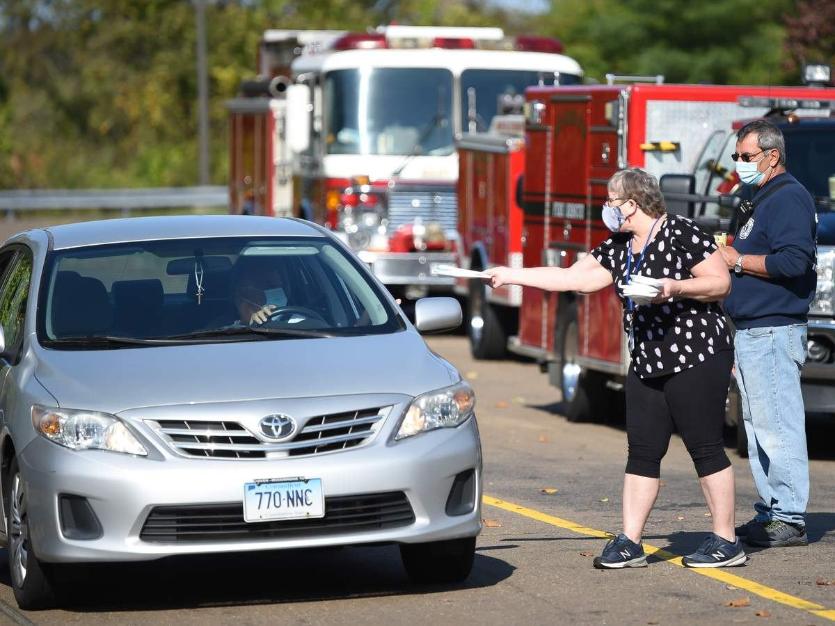 The Town of East Haven held  a mask giveaway to residents in a drive-through event from 10 a.m. to noon on Saturday morning October 10th,  at the East Haven High School. Mickey Malerba EHFD Vol. Company 3, and Kathy Doherty handed out masks.Photo by Kelley Fryer/The Courier