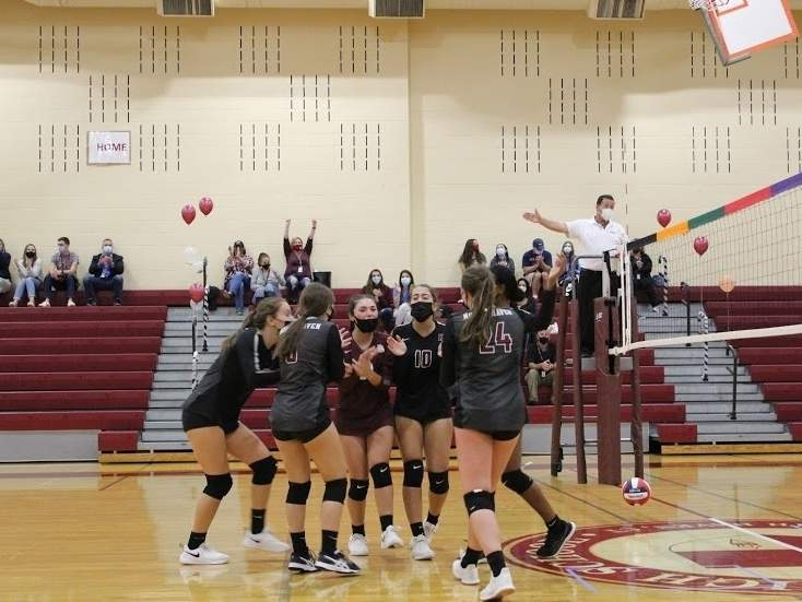 The athletes on the North Haven girls' volleyball team celebrate after scoring a point in a recent contest versus Lyman Hall. Last week, North Haven netted 3-0 shutouts against Sacred Heart Academy and Branford to even its record at 3-3 this year. Photo courtesy of Kristen Bataille