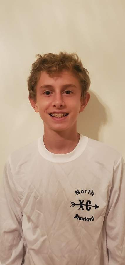 Samuel Gott is impressing during his freshman campaign with the North Branford boys' cross country team. Samuel works tirelessly to improve his times with the T-Birds. Photo courtesy of Samuel Gott