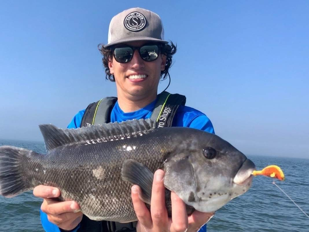 A frequent fisher of Guilford waters, Robb Vossler of West Hartford coaxed this 21-inch, five-pound tautog to his jig before releasing it. Photo courtesy of Captain Morgan