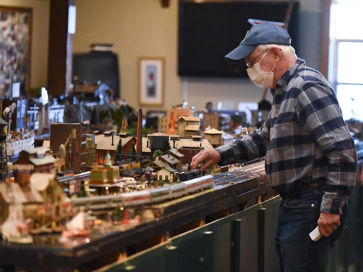 The finishing touches were made on the large Train Show exhibit on Wednesday afternoon at the Connecticut River Museum.  This will be the 27th year of the Holiday Train Show artist Steve Cryan has created. The show will run from November 24th at 10am to February 14th at 5pm.  Due to COVID-19 new protocols are in place requiring any member or non member to purchase timed admission tickets online in advance of their visit. Steve Cryan set the train with the video camera on the tracks. The train's live video feed plaed on a monitor on the wall.  Photo by Kelley Fryer/The Courier