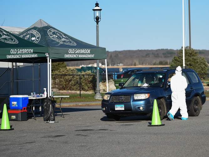 Free COVID-19 drive thru testing provided by a community collabroation between, Community Health Center, Inc., Old Saybrook Office of Emergency Management, Old Saybrook Police, and Connecticut River Area Health District Public Health was busy Wednesday afternoon.  The testing time is 8:30am to 4:00pm Monday - Friday at Saybrook Point, 145 College St, Old Saybrook.  Photo by Kelley Fryer/Harbor News