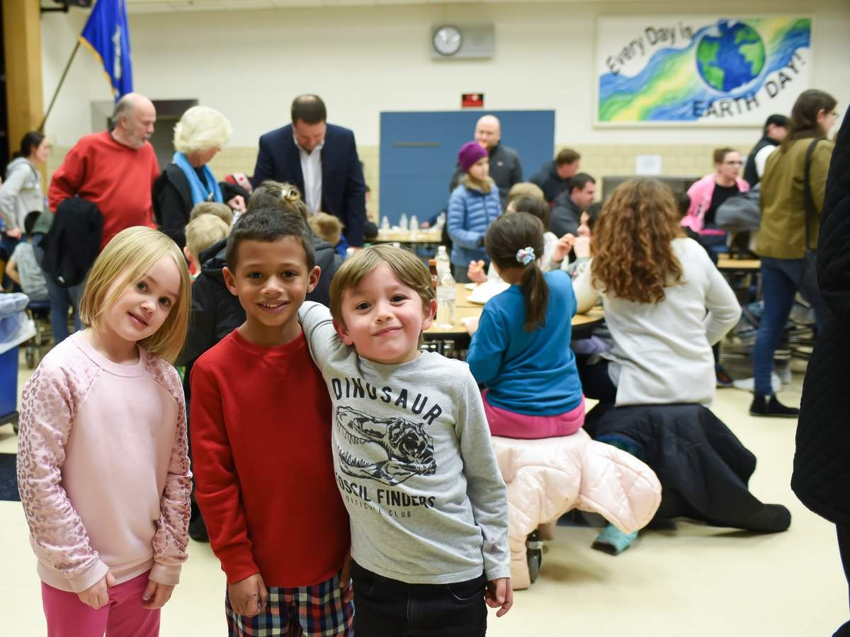 Essex Elementary School held a Family Night on Feb. 28  with pizza and pajama party, bake sale, raffles, crafts raising money for the Essex Elementary School Foundation. Callie Tyrseck, Mason Faison and Jackson Tyrseck pose for a photo in the cafeteria.  Photo by Kelley Fryer/The Courier