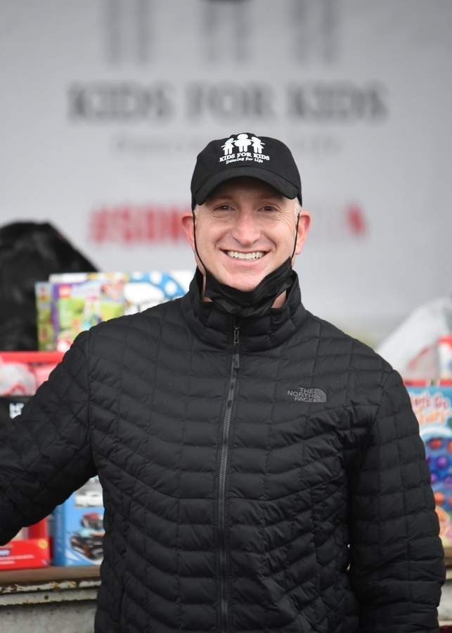 Dan Montgomery will do whatever it takes to support a great cause; he's shown here on Dec. 12 chairing a Toy Drive event in the Washington Commons Plaza on behalf of non-profit Kids for Kids Dancing for Life, Inc. Photo by Kelley Fryer/The Courier