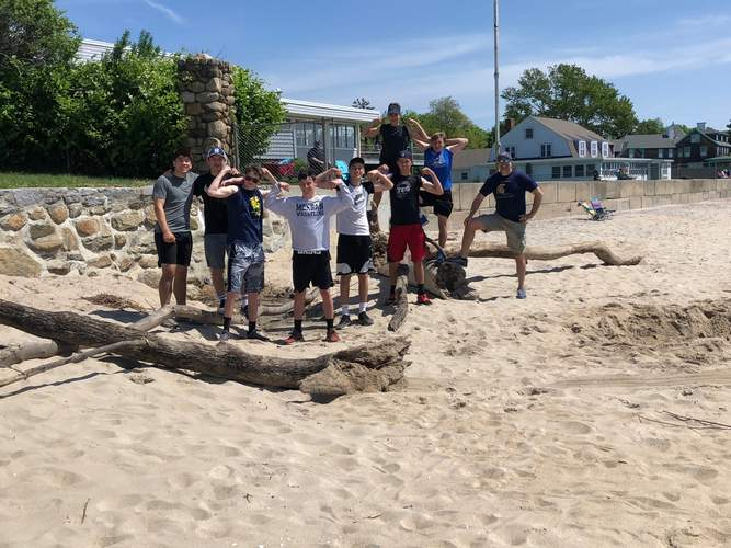 The Spartans cleaned up the beach of the Westbrook Elks Club as part of their commitment to community service. Photo courtesy of Matt Fragola