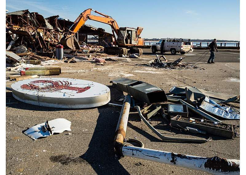 The Dock and Dine restaurant at Saybrook Point, battered by storms Sandy and Irene, was dismantled in 2014. While rebuilding has been a challenge in the flood zone, a new proposal would site a trailer-based outdoor restaurant on the site. Harbor News file photo